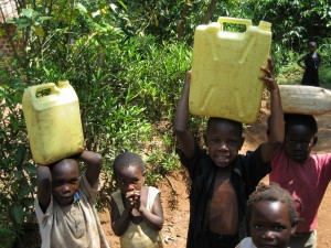 Children Carrying Heavy Jerry Cans of Water